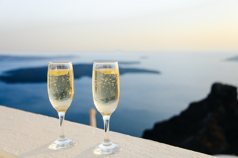 Bubbling champagne framed by the ocean