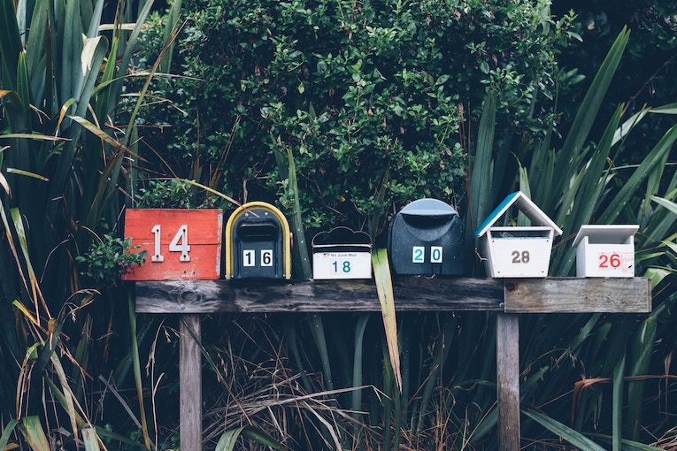 A row of colorful mailboxes