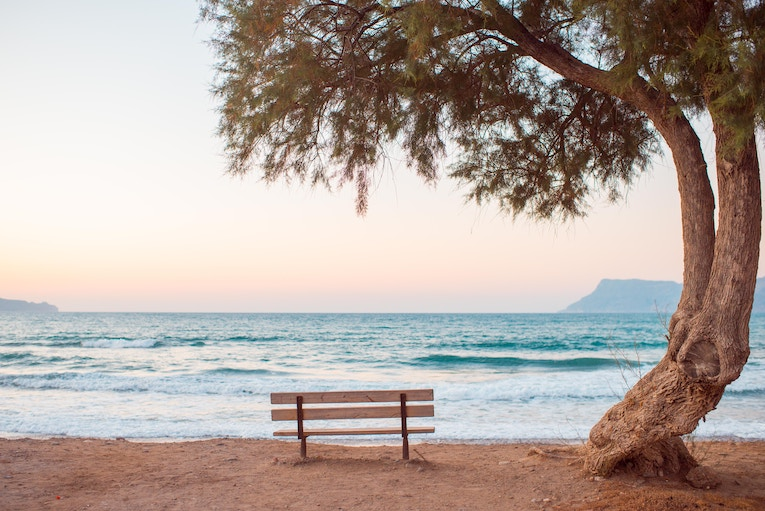 A bench on a beach in Greece