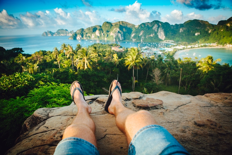 Pair of legs at a scenic overlook in Thailand