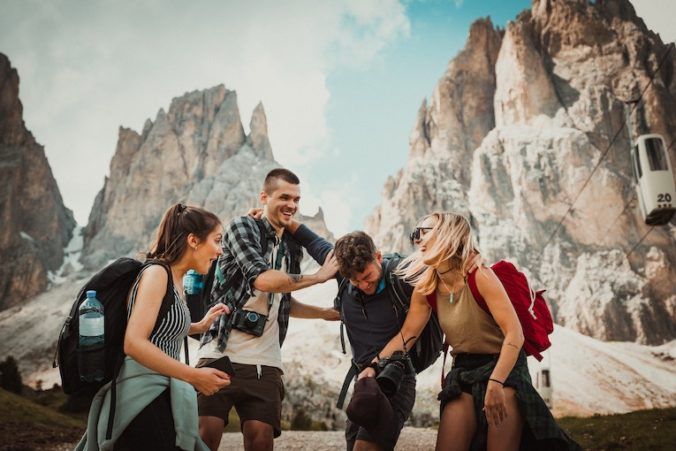 Group of friends laughing in rocky setting