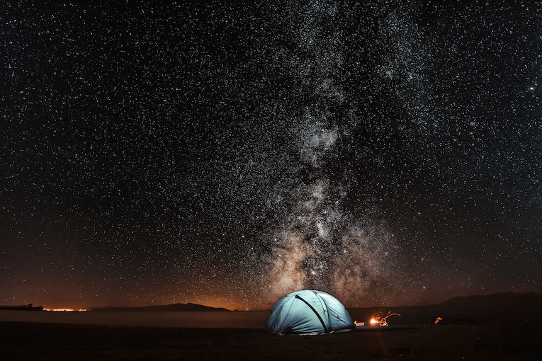 blue tent under the Milky Way