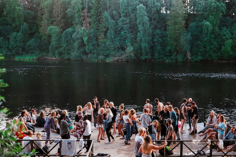 Group of people at a party on lake