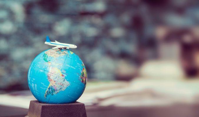toy plane on a globe