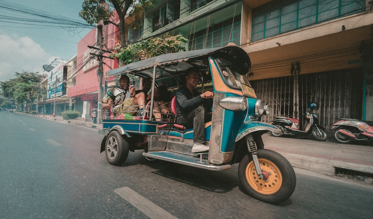 people on tuk tuk in thailand