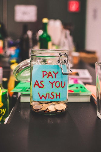 "a tip jar that says ""pay as you wish"""