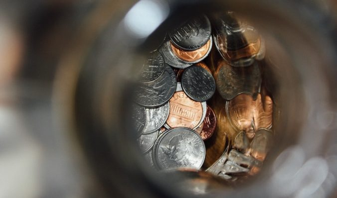focus on coins in a jar from above