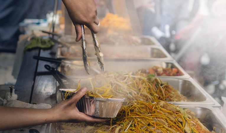 person serving street food