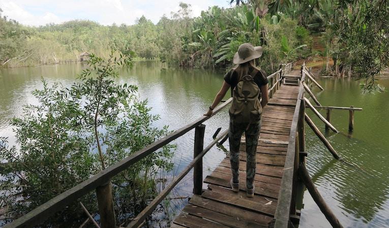 woman crossing bridge in madagascar
