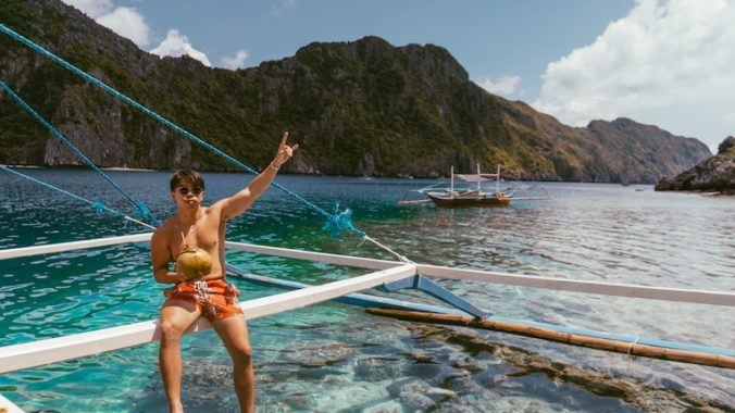 person posing on a boat in palawan, philippines