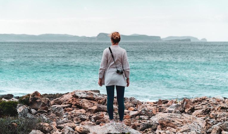 person standing on coast in mallorca
