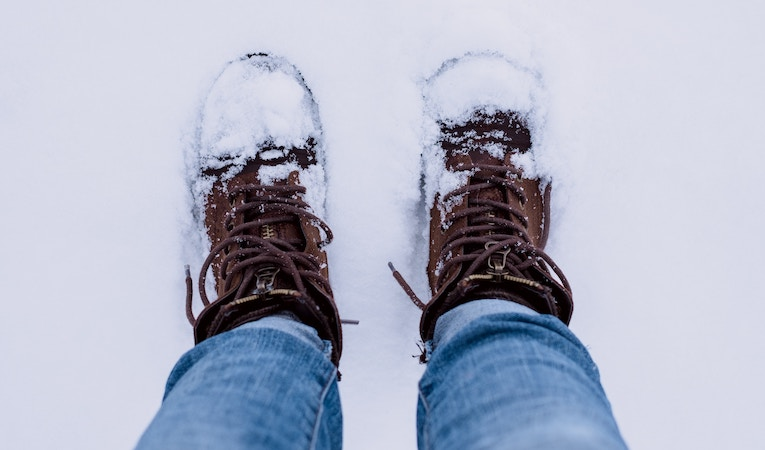 hiking boots covered in snow