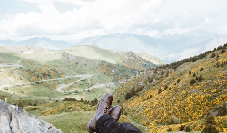 person with their feet up in taull, spain