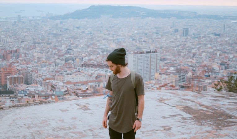 person standing on roof of building in barcelona