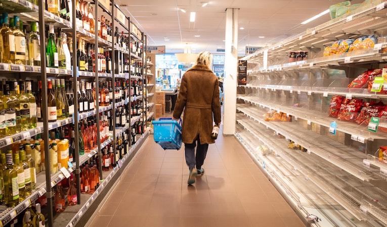 Girl walking through grocery store